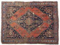 An antique rug - 145 x 198cm Localised wear