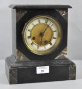 A Slate and marble mantle clock, with roman numerals on enamel denoting hours,