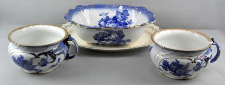 A Doulton Burslem Gloire/de dijon pattern toilet set comprising wash bowl and two chamber pots,