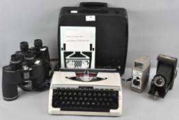 A Bell and Howell 8mm movie camera, a folding Kodak camera,
