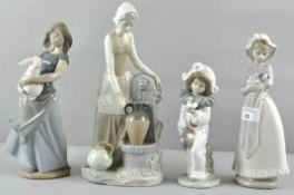 Four Nao female figures,