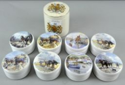 A collection of nine lidded pots,