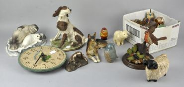A collection of assorted animals figures, to include a Boerim seal and pup, a sheep and dogs.
