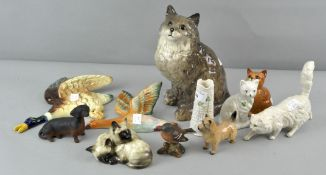 A collection of assorted animal figures including Beswick, Doulton and Beleek,