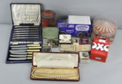 A collection of assorted costume jewellery, cased flatware and vintage advertising tins,