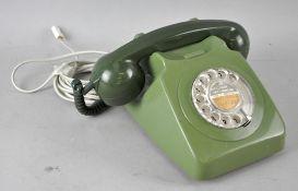 A GPO two tone green 746 rotary telephone