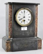 A 19th century black slate and specimen marble mantel clock with white enamel Roman dial,