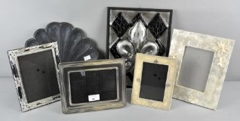 A collection of assorted photograph frames together with two decorative plaques,