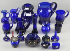 A collection of assorted blue glassware vases, jugs and more by Bristol blue,