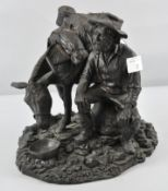 A Bronzed resin style sculpture of a Prospector taking a rest and feeding his donkey,