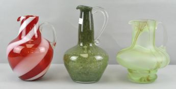 Three Studio glass water jugs, to include : Clouded, candy cane swirl and bubble control designs,