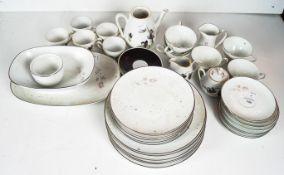 A Noritake tea set along with a Winterling part tea set. Noritake teapot measures; 16cm high.