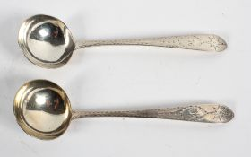 A pair of Irish silver sauce ladles, with round bowls on navette shaped handles,