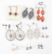 A collection of ten pairs of earrings of variable designs, some marked for silver 925.