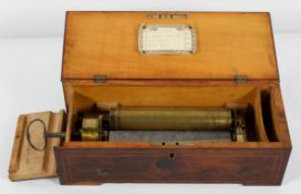 "A Swiss music box, stamped BB, 13627, four airs 8"" cylinder, in a yew wood case,"