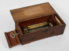 A 19th century Swiss single movement music mahogany box, dropside with keywind mechanism,
