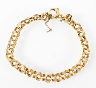 A yellow metal bracelet with trigger clasp.
