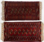 A near pair of Tekke Bokhara style rugs, with Kelim ends, 110cm x 51cm,