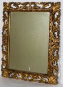A 19th century carved gilt mirror, with scrolling pierced acanthus frame,