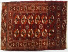 A Tekke Bokhara rug with medallions on a red ground,
