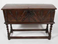 An oak chest on stand, the chest late 17th century, the base possibly later,