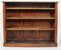 A late 19th century oak bookcase with three adjustable shelves,