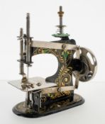 "An early 20th century miniature sewing machine marked ""made in Germany"" underneath an Eagle"