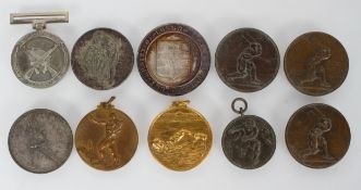 A Rugby competition medal, 3.3cm diameter, and further medals
