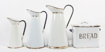 A collection of vintage enamelled kitchenalia, comprising : three tapering conical jugs,
