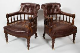 A pair of Victorian leather upholstered tub armchairs, with button stud decoration to back,