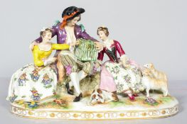 A Continental porcelain figure group, late 19th century, indistinct blue crowned mark to reverse,