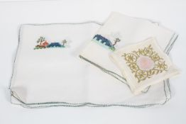 A collection of early to mid 20th century embroidered linen place mats,