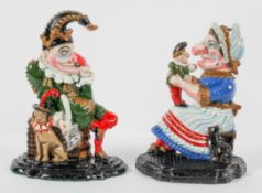 Two 20th century painted cast iron door stops, modeled as Punch and Judy,
