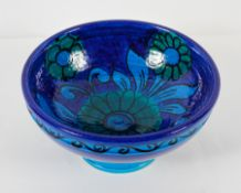 A Bellini pottery, 1960's footed bowl, outlined in black with a stylised flower,