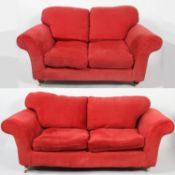 A velvet upholstered three seater club style sofa, with low back and curved arms,