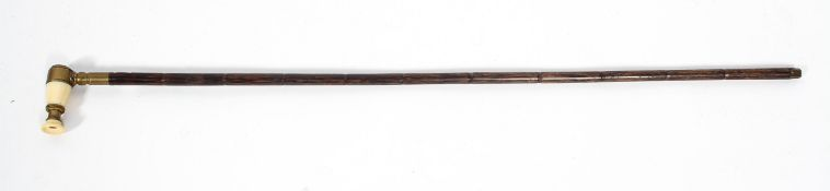 An early Victorian walking cane with monocle handle,
