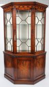 A reproduction George III style mahogany glazed display cabinet, of canted D-section,