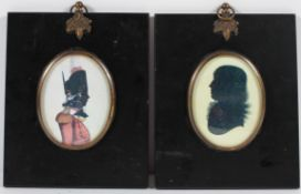 Two early silhouettes of a soldier and a gentleman, in 19th century style frames,