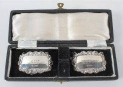 "A pair of silver decanter labels ""Gin"" and ""Sherry"" in original case,"