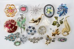 A collection of twenty costume brooches of variable deigns.