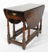 An 18th century oak gate leg dining table,