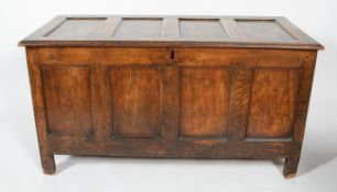 An 18th century coffer, of panelled construction, the top and front with four recessed panels,