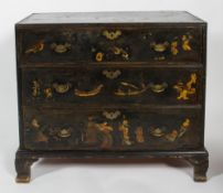 A George III Japanned black and gilt chest with three drawers with brass bat wing shaped handles