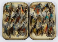 A vintage Japanned metal fly box with flies,