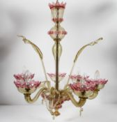 A 20th century Murano glass six branch chandelier with floral inserts,