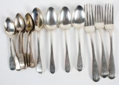 A group of assorted Irish silver flatware, comprising : four Old English pattern dessert spoons,