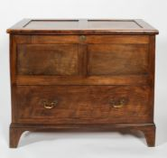 A Welsh coffer, of panelled construction with lower deep drawer and brass handles, on bracket feet,