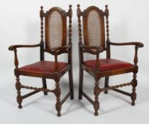 A pair of Victorian oak armchairs, in the 17th century style,