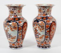 A pair of Chinese 'Imari' pattern baluster vases, 19th century, each with everted neck,