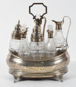 A George III Silver eight bottle cruet set on stand,